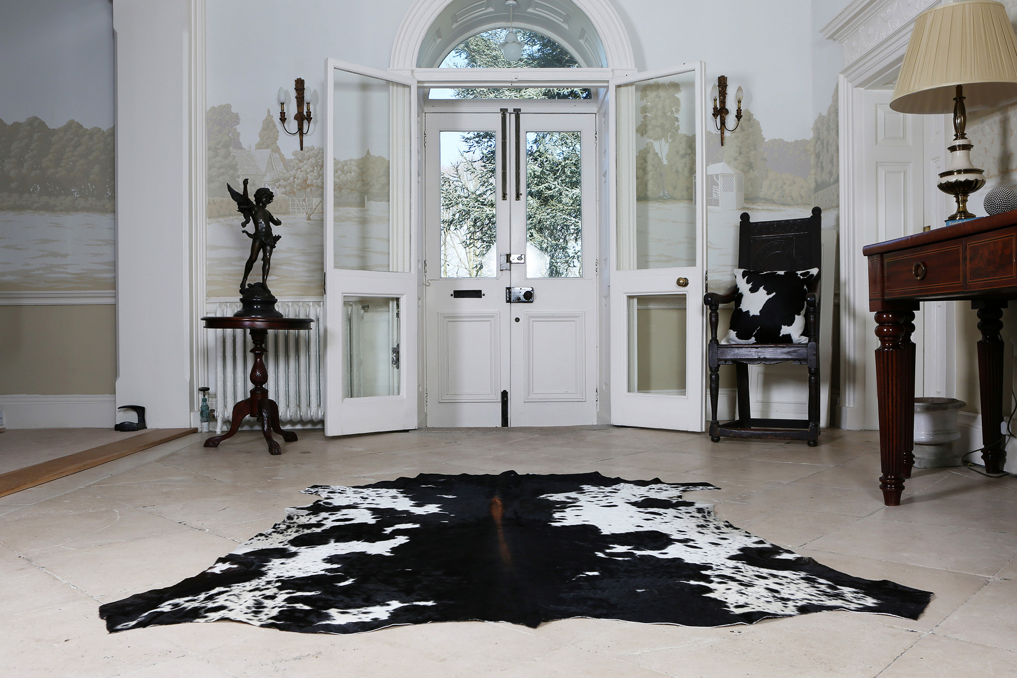 Nguni cowhide rugs, black and white hides, grey cowhides, skins, animal print, cowhide, luxury rugs, interiors, home interiors, interior styling, soft furnishings, sustainable, ethical, skins, by product, hallway decor,