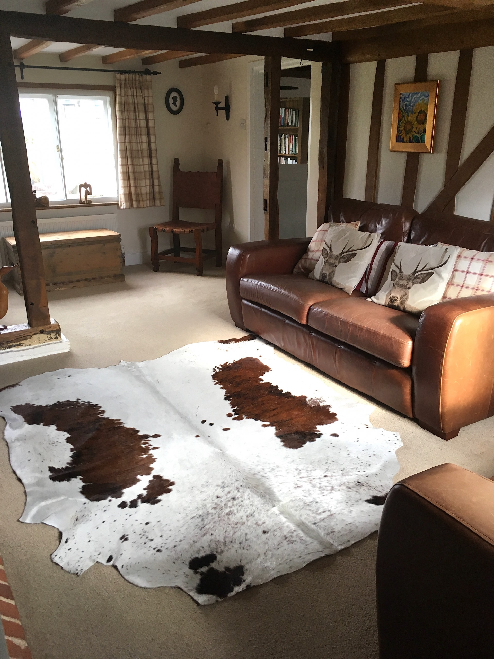 Nguni cowhide rugs, brown and white rugs, cowhides, skins, animal print, cowhide, luxury interiors, home interiors, interior styling, soft furnishings, sustainable, living room decor, floor art