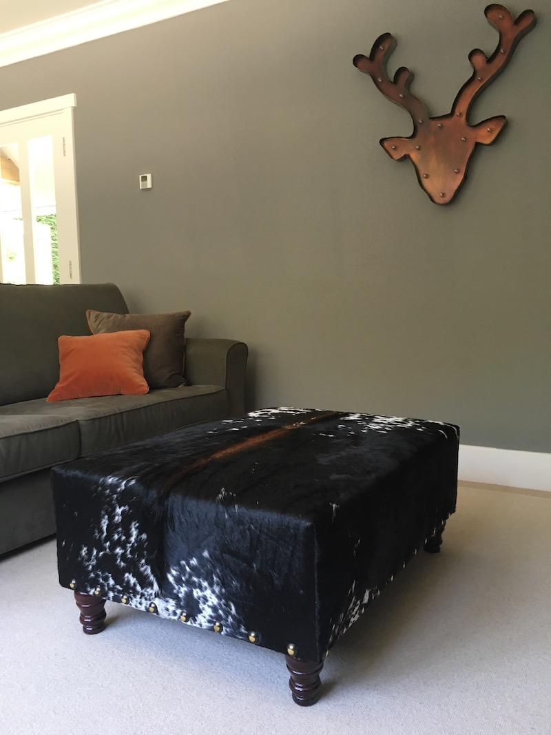 Nguni cowhide ottoman, cowhide furniture, cowhide footstool, Nguni, interiors, custom made bespoke cowhide furniture, luxury interiors, interior design