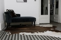 Nguni cowhide rugs, black and brown and hides, cowhides, skins, animal print, cowhide, luxury interiors, home interiors, interior styling, soft furnishings, sustainable, ethical, sustainable interiors, socially conscious brand, Nguni cowhide