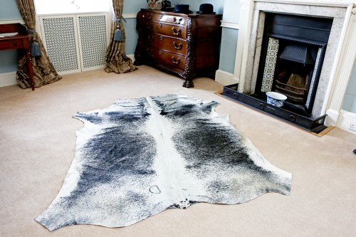 grey cowhide rug, anima print rug, skin, hide, living room decor, country house style, living room decor, floor art, natural rugs