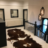 Zulucow Nguni cowhide rug, brown and white rug, animal skin, by product, luxury interiors, home interiors, interior styling, soft furnishings, sustainable, ethical, living room decor, floor art
