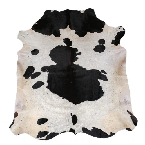 Zulucow Nguni cowhide rug, black and white rug, animal skin, by product, luxury interiors, home interiors, interior styling, soft furnishings, sustainable, ethical, living room decor, floor art