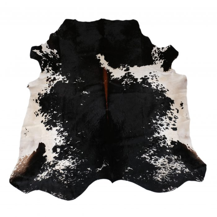 Zulucow Nguni cowhide rug, tricolour rug, animal skin, by product, luxury interiors, home interiors, interior styling, soft furnishings, sustainable, ethical, living room decor, floor art
