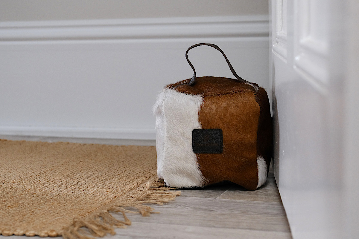 brown and white cowhide doorstop