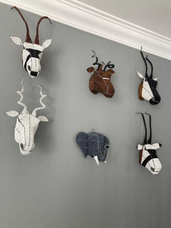 Collection of 6 beaded animal heads mounted onto a Grey wall for decoration