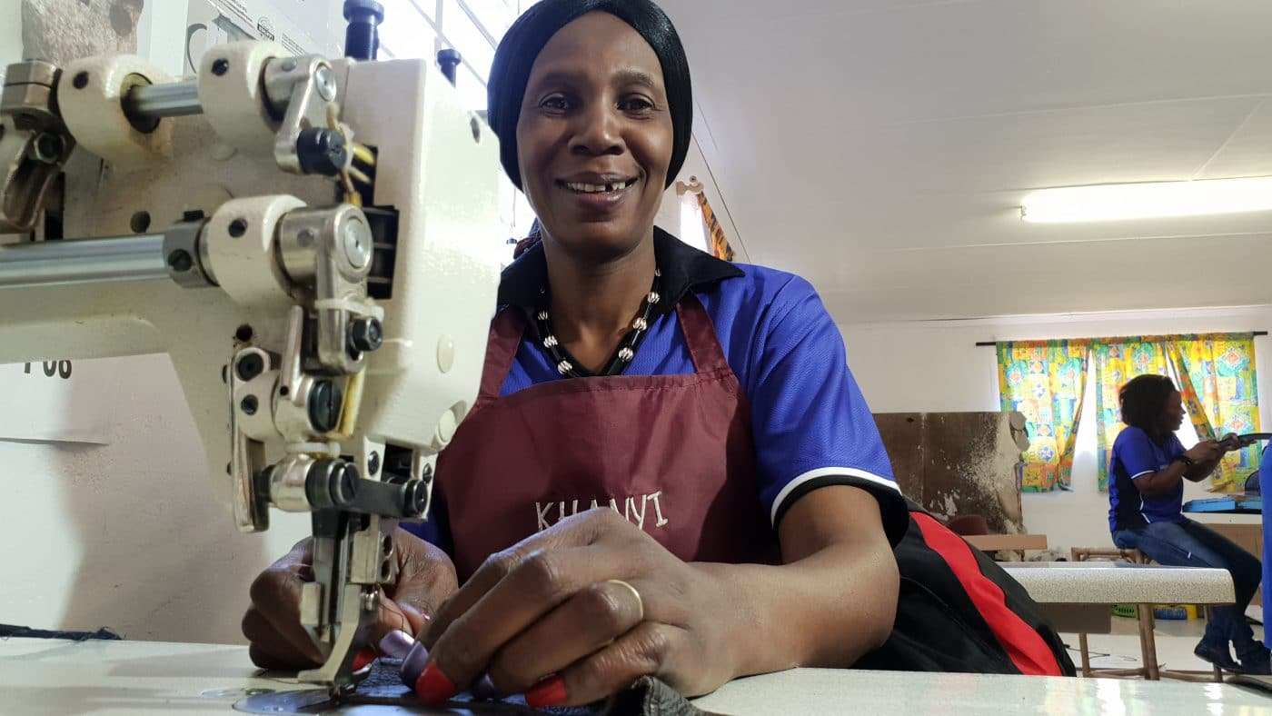 Women sewing cowhide leather for our ethically sourced products