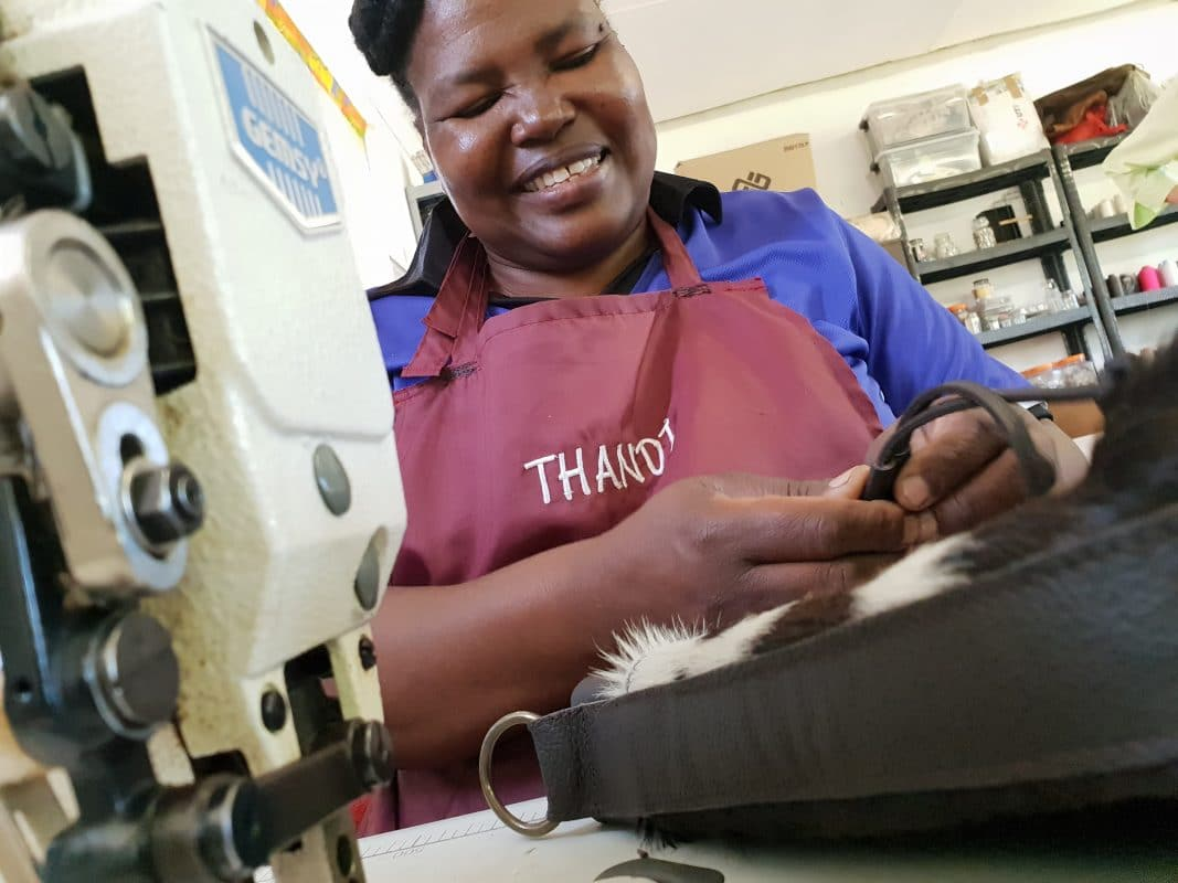 Women working on our handmade cowhide ethical products