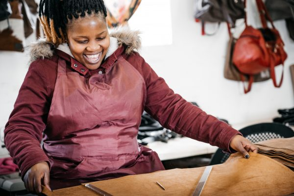 Craftswomen in the workshop creating zulucow products